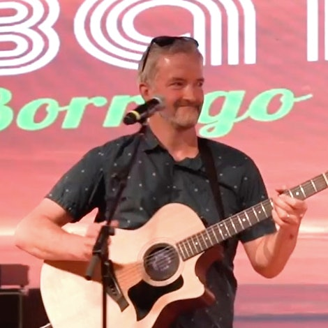 Brendan Neagle with guitar