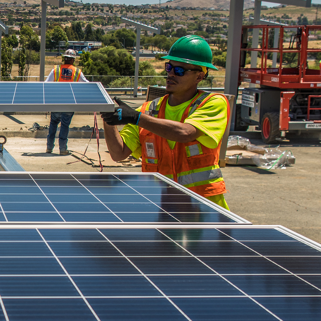 solar panels being carefully installed by technician